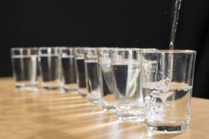 8 glasses filled with water