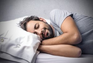 man who uses Progentra sleeping soundly