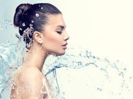 woman with great skin splash water