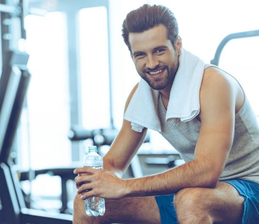healthy man in gym happy about Progentra