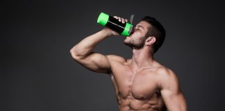 muscular man drinking protein supplement along with Progentra
