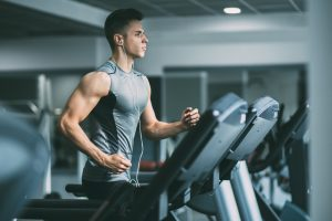 buff guy running in treadmill has more energy with Progentra