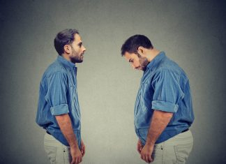man with poor body image looking at his overweight version