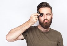 man with adult ADHD holding fidget spinner was introduced to Progentra pills