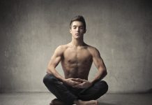 young man who learned about Progentra meditating with yoga