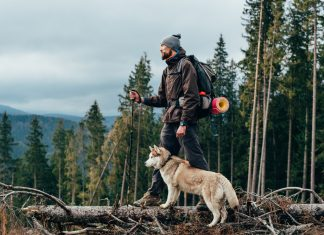 Progentra user hiking in the winter with his dog