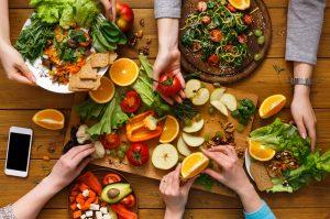 Vegan friends sharing a meal