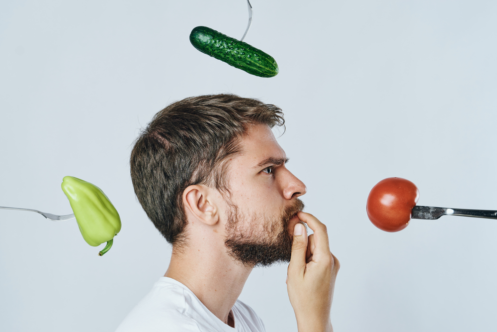 man deciding on veganism