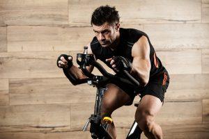man doing cardio on bike