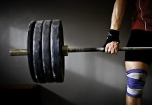 strong man weightlifting in gym