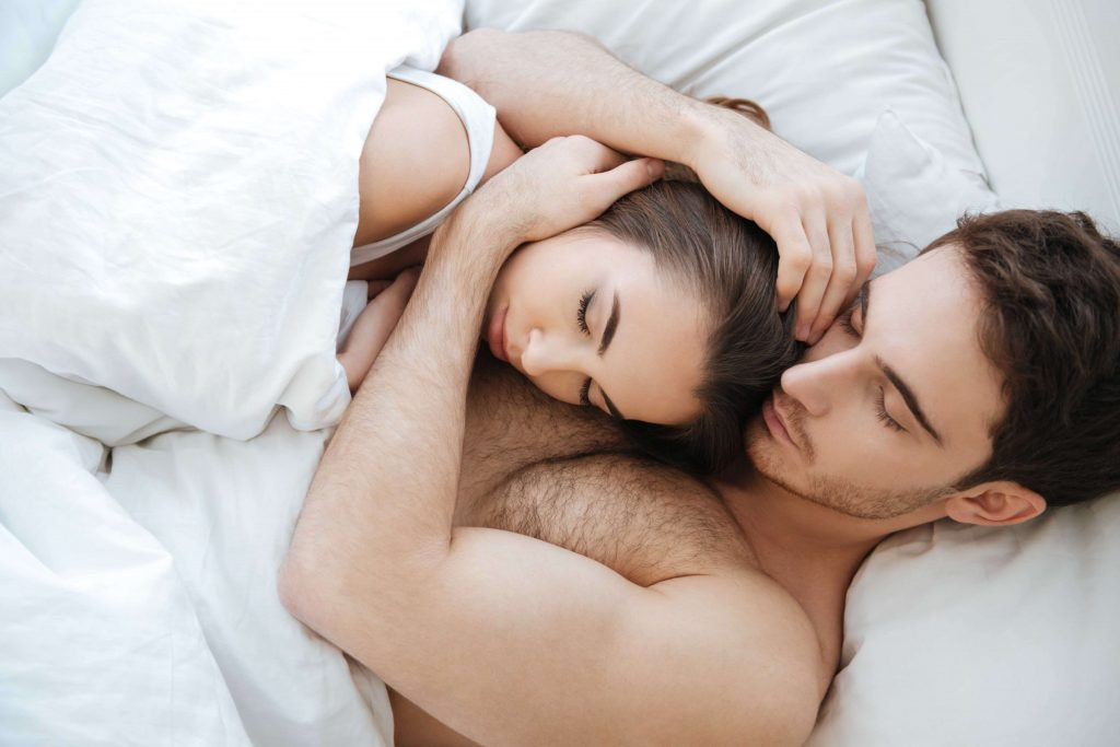 couple sleeping and cuddling