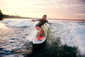 woman enjoys surfing
