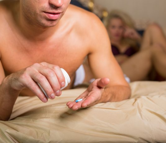 man taking a pill before sex